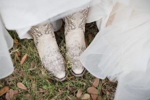 wedding detail photos, sarasota wedding photographer, cowboy boots wedding detail, Sarasota lifestyle photographer, fireworks wedding, creative Sarasota photographer, florida wedding photographer, bridal cowboy boots, modern wedding photography, Horse and carriage wedding, sarasota wedding, Sarasota backyard wedding, Sarasota wedding photos, Rustic wedding photos, Rustic wedding details, Rustic ceremony photos, custom wedding ties, custom wedding aisle runner, rustic wedding furniture
